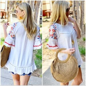 Ivory embroidered detail tunic